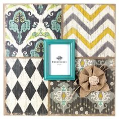 """Display a treasured memory in true modern style with this 5"""" x 7"""" Patterned Wall Frame with Burlap Flower!    This oversized hollow-back MDF frame features distressed edges, a black and ivory diamond pattern, a turquoise, ivory, navy blue and lime green ikat pattern, a gray, mustard yellow and ivory chevron pattern, and a light and dark gray, yellow, turquoise and ivory ikat pattern with a burlap flower accent, all centered by a turquoise-bordered glass-covered photo opening.   ..."""
