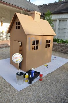 Painting a cardboard house is a perfect activity for the party guests to enjoy. Everyone can get in on the action. ---Image Only