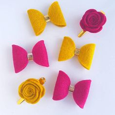 Gorgeous felt rose clips. Prefect for little fringes. Hand rolled in a variety of colours. Available in a variety of colours. Can be set on either rose gold, gold or silver alligator clips. Approx 1 inch wide flower. Clip is 1.5 inch approx. Made with soft wool felt. Please note
