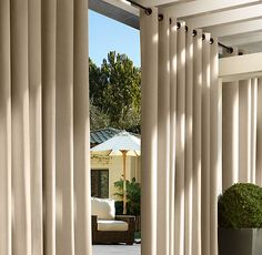 Restoration Hardware -  outdoor drapery ideas... could these go over or replace the blinds in the screened in porch?