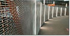 Brocklebank architectural pre-crimped wire mesh installed as security screening at the underground Midtown Cycle Vault at Bloomsbury Square, London. Security Screen, Wire Mesh, Bloomsbury, Vaulting, Radiators, Screens, Blinds, Stairs, Home Appliances