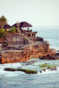 The breathtaking Tanah Lot Sea Temple is perched atop an enormous rock. - the best of Bali in 9 days #Jetsetter