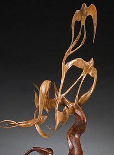 a escultura em madeira e poesia de j Christopher White