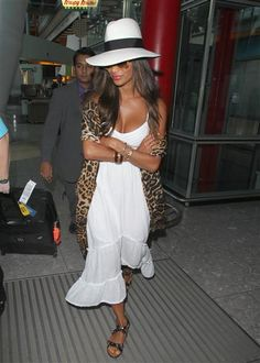 Nicole Scherzinger wore a leopard-print scarf with her white sundress at London's Heathrow Airport on Aug. 28, 2013.RELATED: The 15 worst girl band hairstyles