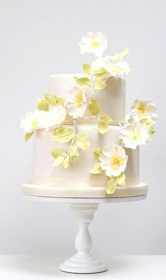 Pretty Yellow & White Flowers on Two Tiered White Cake