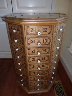 Antique display cabinet for a general store that would have held screws and bolts.