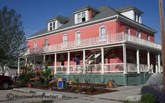 Picture of the pink Stevensville Montana Hotel.