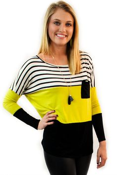 Lime Green Striped Top - $36.95 - Lime Green Striped Top now available at Envy Boutique. Let that bright personality shine thru in this roomy and comfortable top, it works it way from white with black stripes to a wide lime green center and finishes off with a solid black lower section.  | available at http://www.envyboutique.us/product/lime-green-striped-top/ |  #Envy #Boutique #fashion #fashiontrends