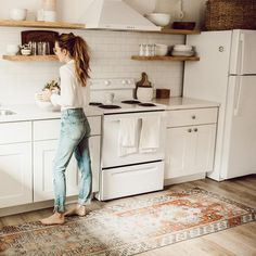 White kitchen with vintage rug.
