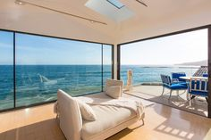This eclectic modern 6,000 sf beach house has the coolest chandeliers and the most awesome decor. Located in Malibu Colony, it is almost startling in its boldness. But it all...