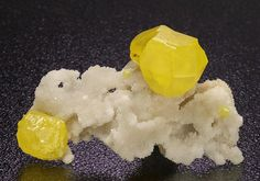 Fine aesthetic bright yellow well formed intergrown and single crystals on a druse crystallized partitioned Aragonite matrix, from the Agrigento Province, Sicily, Italy.  Crystal Classics Minerals