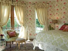 Unique window treatments complete a room. Designer Shelly Riehl David creates custom puff-top silk draperies for this romantic and feminine bedroom.