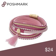 Wrap Bracelet This adorable multi cord pink bracelet features gold tone magnetic closure with tassel accent. Measures 15.5 inches. (This closet does not trade) Boutique Jewelry Bracelets