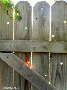 Boring fence. Drill holes and place marbles in it. Neat idea. :)