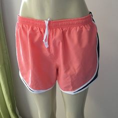 New Nike Tempo Running Shorts M Condition: New with tag retail $30 Note: Nike pink with black white trim running train shorts  #44   Check my other listing and save combine discount. I also sell Men's women's jeans t-shirts tops pants skirts dress athletic sweatshirt sweatpants sweater poncho shrug jogger tank tops shoes boots designers etc.Brand such as Nike , Buckle,Levi's Guess Miss Me Rock Revival , flare slim straight boot denim jeans MK Michael Nike Shorts