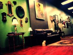 Interior of The Jaded Gypsy Tattoos in Rock Island, IL. John Kautz, the artist that I have been working with for my sleeve is working here now. He does great work, and they just so happen to have a similar color scheme to what I am thinking about for our reptile room / basement. I'll probably not do an insane red floor though :)