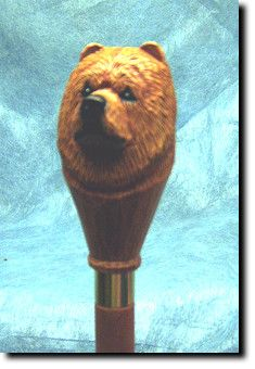 Chow Chow Dog Walking Stick. The Chow Chow Dog Walking Stick is a reproduction of an original woodcarving by Michael Park, a Master woodcarver, recognized worldwide for his detailed carvings and reproductions. Each walking stick is cast in resin and hand painted by master artists capturing a style of charm and warmth.