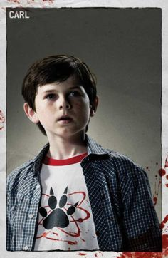 Chandler Riggs as Carl Grimes on the zombie show The Walking Dead