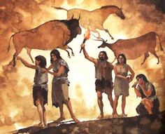 prehistoric people in cave doing cave paintings. They didnt have electricity so they would use torch light to see things around them