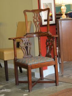 Antique high-backed chair. Very ornate!