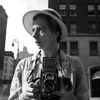 Vivian Maier  1926-2009                          HER DISCOVERED WORK THIS WAS CREATED IN DEDICATION TO THE PHOTOGRAPHER VIVIAN MAIER, A STREET PHOTOGRAPHER FROM THE 1950S - 1990S. VIVIAN'S WORK WAS DISCOVERED AT AN AUCTION HERE IN CHICAGO WHERE SHE RESIDED MOST OF HER LIFE. HER DISCOVERED WORK INCLUDES OVER 100,000 MOSTLY MEDIUM FORMAT NEGATIVES (90% OF HER WORK), THOUSANDS OF PRINTS, AND COUNTLESS UNDEVELOPED ROLLS OF FILM.