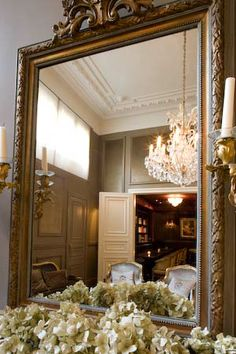 Mirror gives insight into stylish panelled room