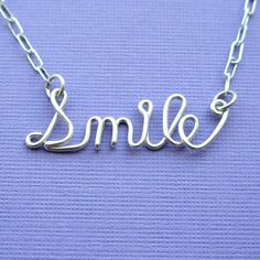 Smile (sterling silver wire word necklace). $36.00, via Etsy.