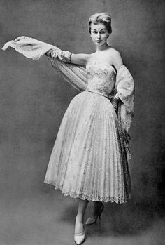 Monique Chevalier in pale rose evening dress of pleated embroidered lace with lace stole by Christian Dior, photo by Georges Saad, 1956