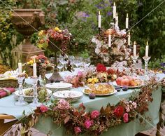 Apple cake, pomegranates, figs, garland of roses and rose hips