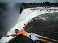 waterfall in Africa where you can swim at the edge! It's real and I want to go!