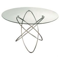 Fun for a small space dining room.  The glass top makes the space appear bigger.