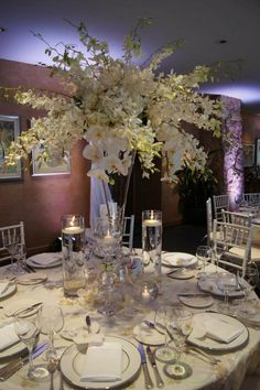 Beautiful tall white wedding centerpiece.
