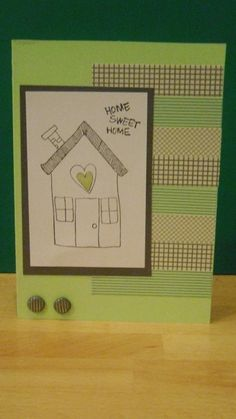 Modern but cute green and grey new home card