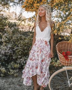 """c625cee300f K I V A R I on Instagram  """"Spring days spent exploring with our Kivari muse   elisecook looking stunning in the Beni Lace Cami and Sophia Floral Maxi  Skirt ..."""