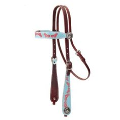 This fun, brightly colored shaped headstall is sure to catch the eye! It blend an old style buckaroo design with a fantastic design. Printed Action Leather, double and stitched on a heavy latigo backing means these headstalls are designed to be used. The colors are protected from fading even when exposed to sunlight, sweat and rain and best of all they are affordably priced!  Made in U.S.A.  