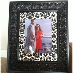 Damask fabric matting that I did in this 11x14 frame, then placed my best friends engagement photo in for her birthday gift!