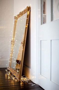 would love to string lights like this on that large mirror from Ikea!