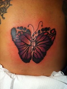 Butterfly footprint tattoo if I have a girl I am so getting this!!! With her initials in the middle.