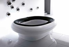 Treesse's modern shape white bathtub with black build-in cushions / Inside Collection