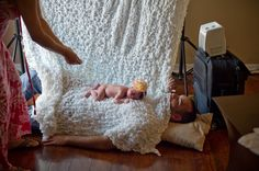 Perfect way to calm a baby during a photo shoot. Yes, I will be making do this when I take pics of our new babe!