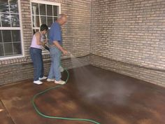 DIY - applying concrete stain. If I ever need/want to do this, I like the look of concrete stain.