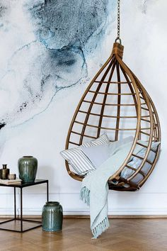 I must own a vintage rattan hanging chair. Style it with a fluffy lambskin rug, add a couple indigo pillows, and you've got yourself a cozy floating nest.