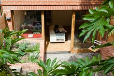 Nimtim Architects created a steeply terraced garden to accommodate their extension to this terrace house in Forest Hill, southeast London Brick Flower Bed, Oak Parquet Flooring, Floors, Brick Extension, Sunken Patio, Plants For Raised Beds, 1960s House, Brick Facade, Gardens