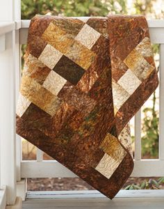 Chocolate Bar from Fall Easy Quilts 2013 is an easy throw size quilt pattern featuring different square and rectangle quilt blocks. Quilt by Tricia Lynn Maloney.