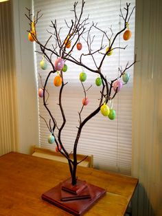 I bought this manzanita tree on Etsy, and used it as the place card holder for my wedding...they were leaves.  Now I use it to hold my necklaces, BUT!  I hung these little eggs on it for Easter (purchased in the $1 section at Target), and it was the cheapest/fastest centerpiece ever!  LOVE IT!