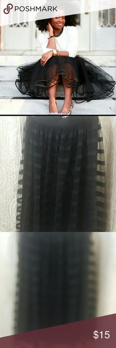 Black tulle tutu skirt Size medium. Used but in great condition. Can be worn to a fancy function or a casual event. So cute and they must have at this price! Dresses