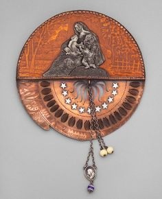 A round copper disk with irregular edges, with engraved and pierced decoration, and an engraved metal image of the Madonna and Child with John the Baptist ,under plexi … Funky Jewelry, Unusual Jewelry, Old Jewelry, Jewelry Art, Beaded Jewelry, Handmade Jewelry, Jewelry Design, Recycled Jewelry, Jewelry Ideas
