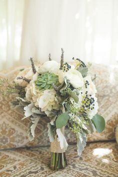 White rose and succulent bouquet by Town and Country Gardens in Geneva, IL. Farm wedding bouquet. White and green bouquet.