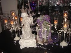 Christmas table display in purple with cherub, birdcage and candles