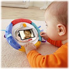 3-in-1 Apptivity Entertainer for iPhone & iPod touch devices - Fisher-Price Online Toy Store ($20.00) •Securely attaches to your stroller for on-the-go fun!  •Easel set up for tummy time & sit-at play  •Sturdy case protects from dribbles & drool    Gross Motor  •Baby-proof for little hands! Lock in your device and watch worry free as baby bats and pats this roly-poly case, enhancing gross motor skills.